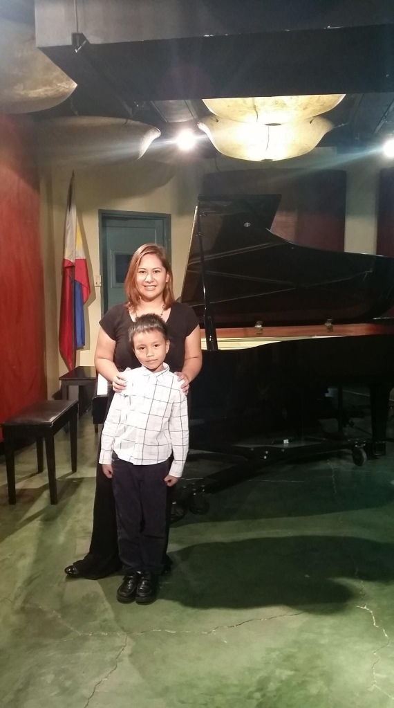 My eldest with his piano teacher Cel